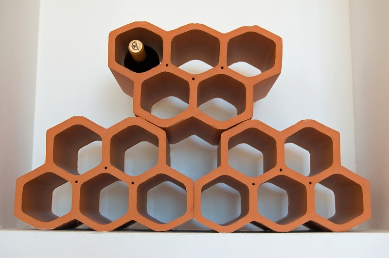 Upgrade your home with a wine rack  Even if you just have a few cheap
