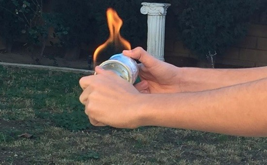 Cut a glass bottle in half with a string lighter it for Cut glass bottle with string and fire